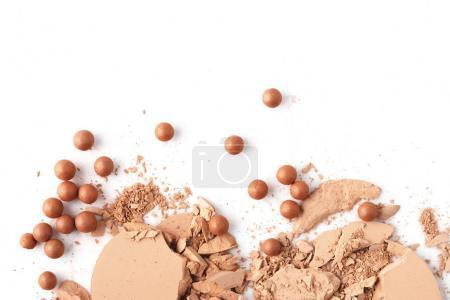 top view of crushed nude cosmetic powder isolated on white