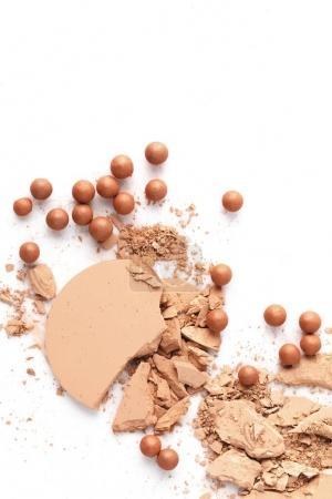 crushed nude cosmetic powder isolated on white