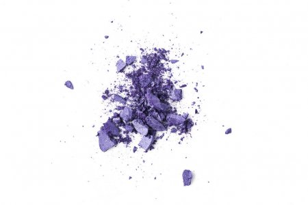 crushed purple cosmetic eye shadows isolated on white
