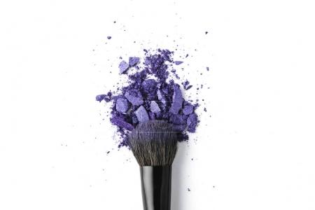 top view of cosmetic brush with purple powder isolated on white