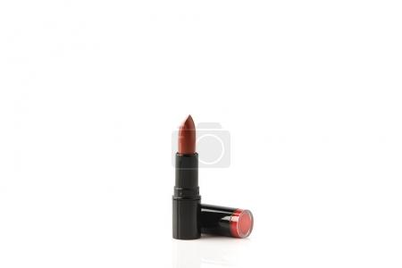 single tube of red lipstick isolated on white