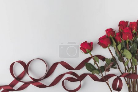 Photo for Top view of beautiful red roses with ribbon isolated on white, st valentines day concept - Royalty Free Image