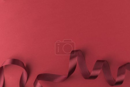 top view of ribbon for decorating presents isolated on red