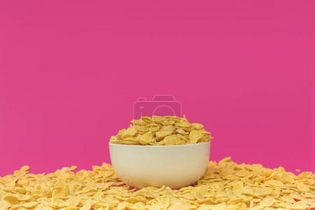 Photo for Close-up view of white bowl with tasty crispy corn flakes isolated on pink - Royalty Free Image