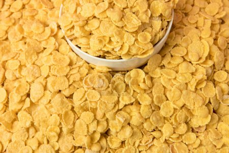 Photo for Close-up view of tasty crispy corn flakes and white bowl - Royalty Free Image