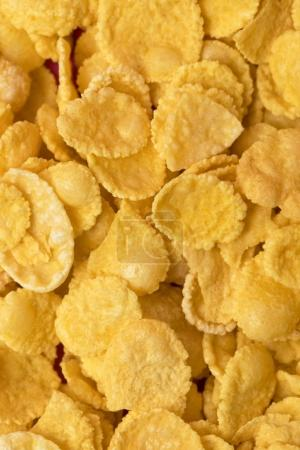 close-up full frame background from healthy crispy corn flakes