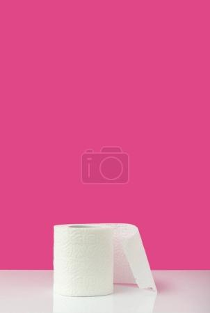 close-up view of white toilet paper on pink