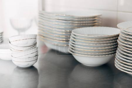 close-up shot of various stacked clean tableware at restaurant