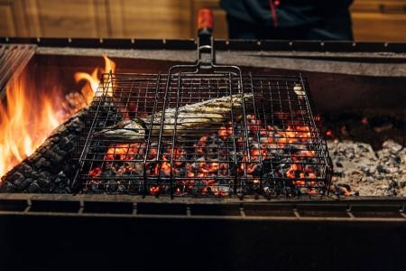 fish in grill bar cooking on bbq