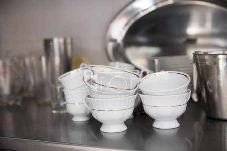 close-up shot of stacked clean tableware at restaurant