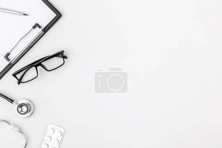glasses near folder with paper and stethoscope isolated on white background