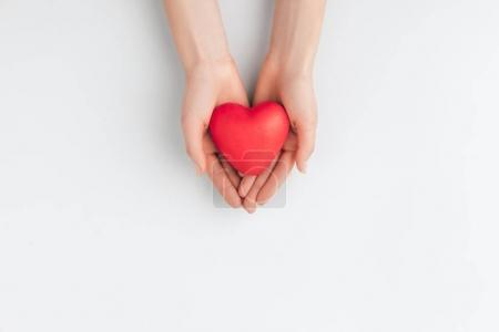 Top view of hands holding red heart isolated on wh...