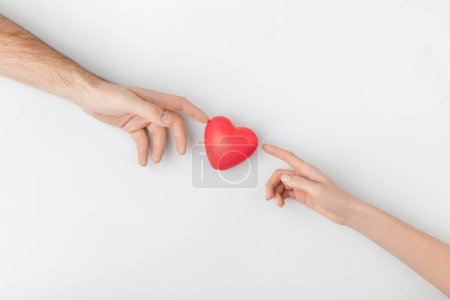 top view of hands touching red heart isolated on white background