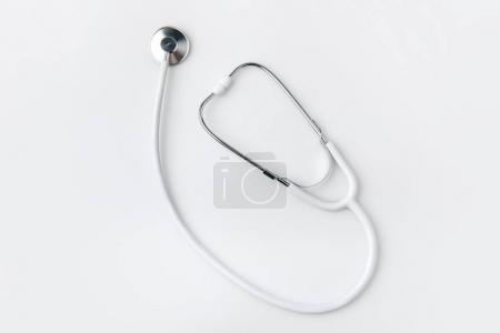 stethoscope laying isolated on white background