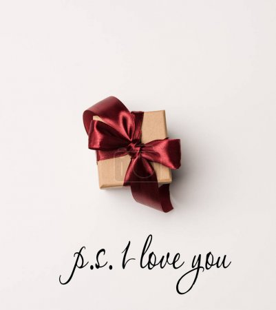 top view of present with red ribbon isolated on white