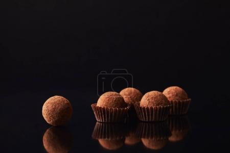 Photo for Close up view of tasty truffles on black - Royalty Free Image
