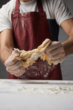 Photo for Cropped image of chef preparing dough - Royalty Free Image