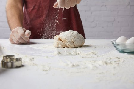 Photo for Cropped image of chef preparing dough and adding flour - Royalty Free Image