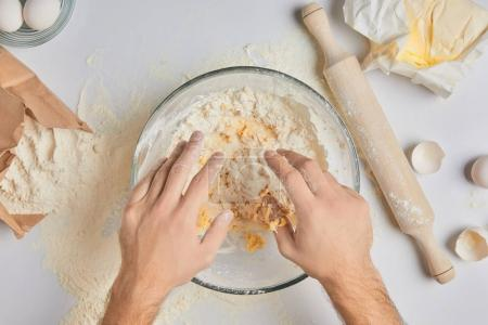 Photo for Cropped image of chef kneading dough - Royalty Free Image