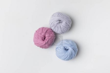 top view of colored yarn balls isolated on white