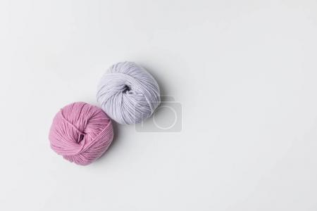 top view of two yarn balls isolated on white with copy space