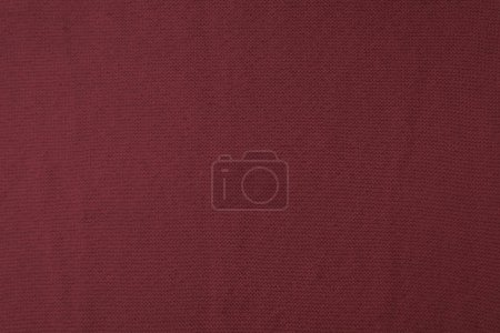 close up view of burgundy woven fabric texture