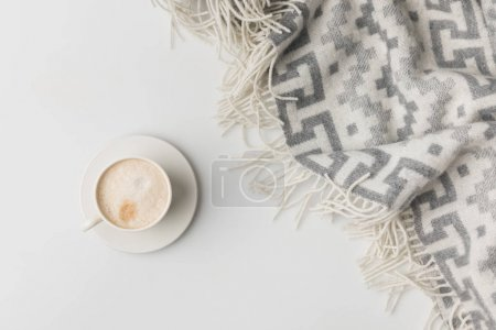 Photo for Top view of coffe cup and blanket isolated on white - Royalty Free Image