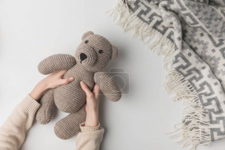 Photo for Cropped view of woman holding teddy bear in hands on white background - Royalty Free Image