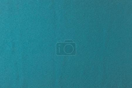 close up view of turquoise fabric texture