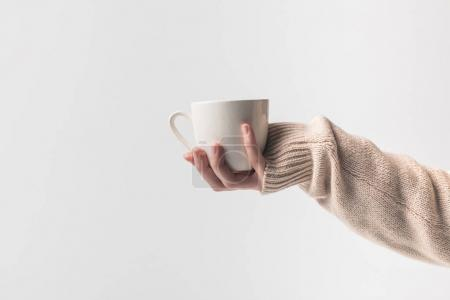Photo for Cropped image of woman holding cup of coffe in hand isolated on white - Royalty Free Image