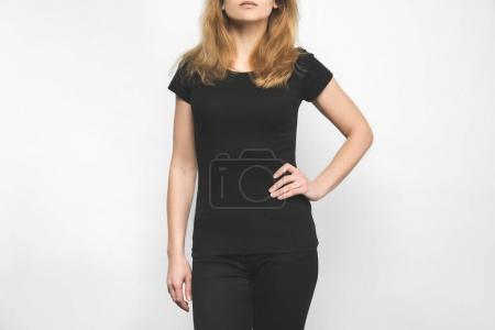 stylish young woman in blank black t-shirt on white