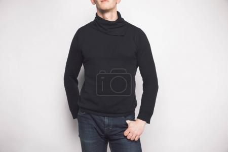 cropped shot of man in black sweater isolated on white