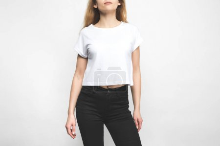 Photo for Attractive young woman in blank t-shirt on white - Royalty Free Image