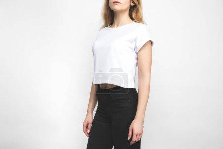 Foto de Mujer elegante en camiseta en blanco sobre blanco - Imagen libre de derechos