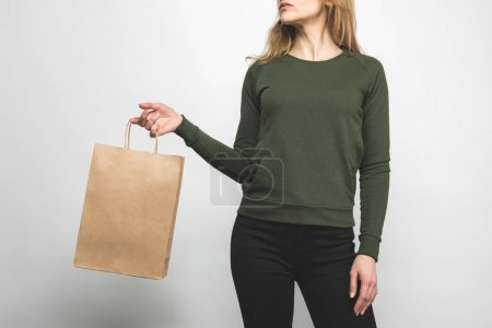 cropped shot of woman in blank green sweatshirt on white with shopping bag
