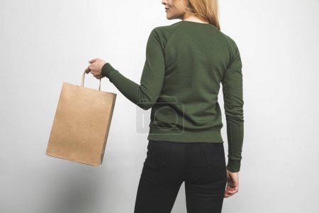 back view of young woman in blank green sweatshirt on white with shopping bag