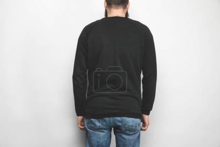 back view of man in black sweatshirt isolated on white