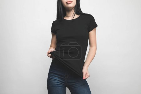 Photo for Stylish young woman in blank black t-shirt on white - Royalty Free Image