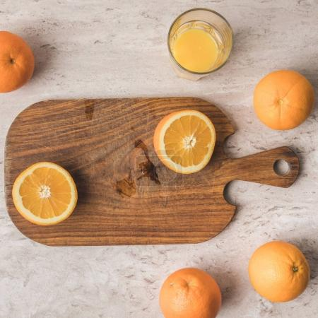 top view of cut orange on wooden board