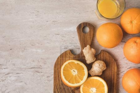 Photo for Top view of oranges and ginger for homemade juice on table - Royalty Free Image