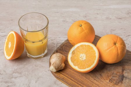 high angle view of oranges and ginger on cutting board