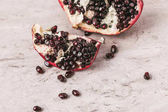 ripe appetizing pomegranate on marble tabletop