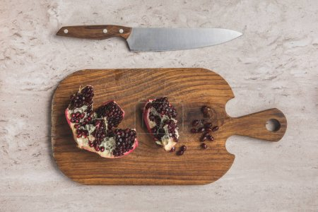 top view of ripe pomegranate on cutting board