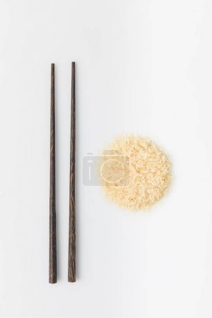 heap of rice with chopsticks isolated on white