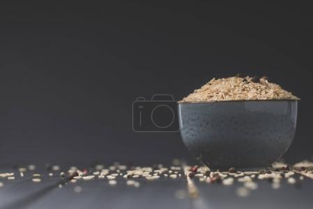 Photo for Bowl of raw rice on black table with copy space - Royalty Free Image