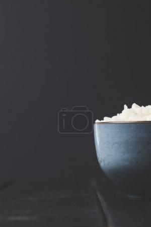 close-up shot of bowl of tasty rice on black table