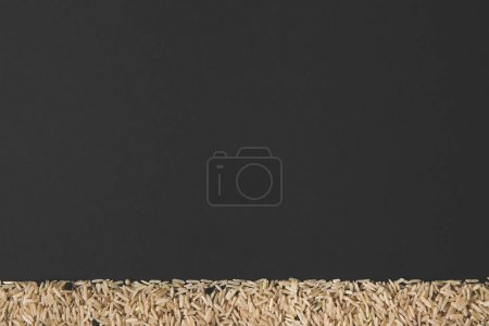 raw rice isolated on black with copy space