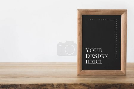 blackboard in frame with text your design here on white