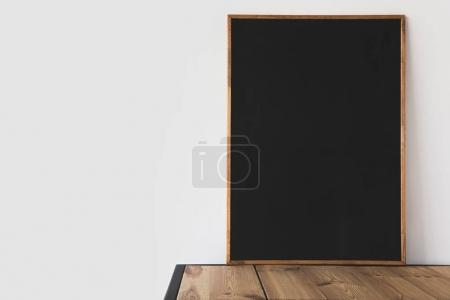 Photo for One big empty blackboard on wooden table on white - Royalty Free Image
