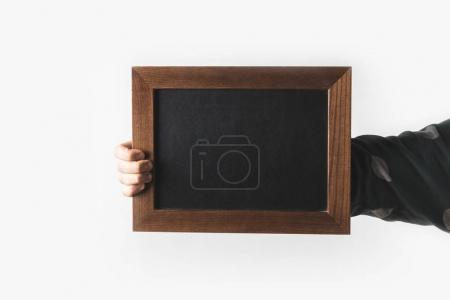 Photo for Cropped image of man holding empty black board isolated on white - Royalty Free Image